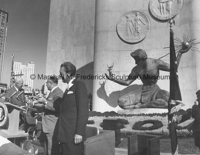Detroit Mayor Louis C. Miriani presents President Dwight D. Eisenhower with a small-scale bronze of The Spirit of Detroit.jpg