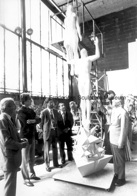 Marshall Fredericks and a group of unidentified men admire the plaster model for Star Dream Fountain.jpg
