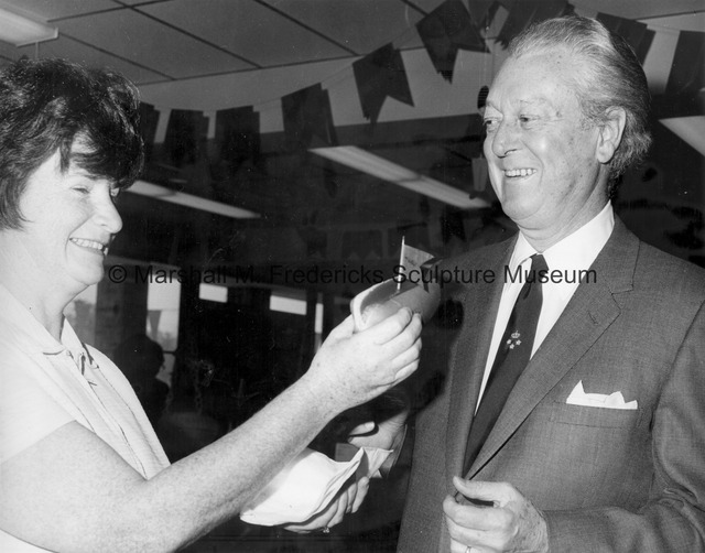 Marshall Fredericks is presented with a hot dog at the Northville Danish Festival.jpg