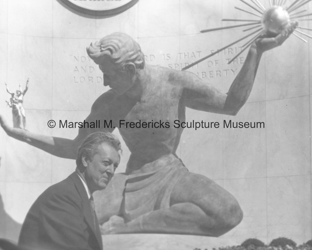 Marshall Fredericks poses with The Spirit of Detroit at the City-County Building.jpg