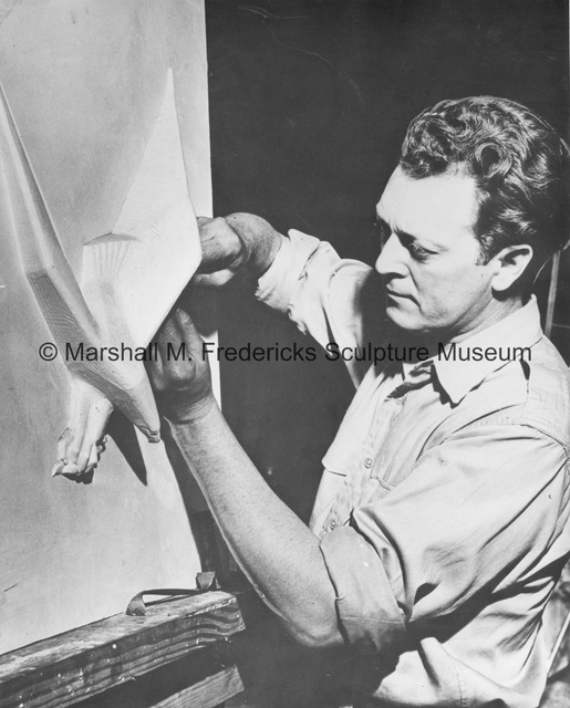 Marshall Fredericks working on the small-scale plaster model of Victory Eagle (American Eagle) for the Veterans Memorial Building in Detroit.jpg