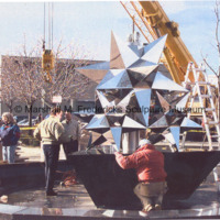 A worker inspects the base for Star Dream Fountain.jpg