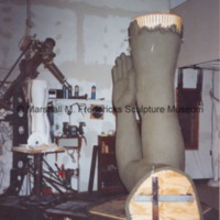Alternate side view of the plasteline arm and legs for Star Dream Fountain with plaster model in the background.tif