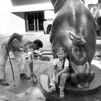 An unidentified child sits on Two Bears at Interlochen Center for the Arts.jpg