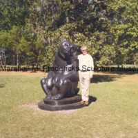 An unidentified man poses with Two Bears at Brookgreen Gardens.tif