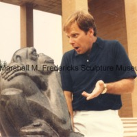 An unidentified man pretends to converse with The Thinker on the steps of the Cranbrook Art Museum.tif