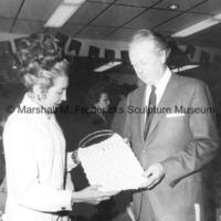 An unidentified woman shows Marshall Fredericks a purse at the Tivoli Fair.jpg