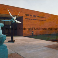 Bronze Female Baboon, Flying Pterodactyls and Male Baboon in front of the entrance to the Marshall M. Fredericks Sculpture Museum.jpg