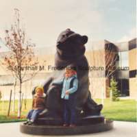 Children pose with Two Bears at the Sterling Heights Public Library.jpg