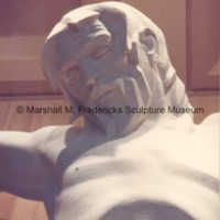 Close-up view from below of the plaster model of Christ on the Cross in the Marshall M. Fredericks Sculpture Museum.tif