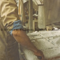 Close-up view of Marshall Fredericks working on an unidentified relief in his Royal Oak studio.tif