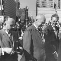 Detroit Mayor Louis C. Miriani, President Dwight D. Eisenhower, and Marshall Fredericks visit The Spirit of Detroit.jpg
