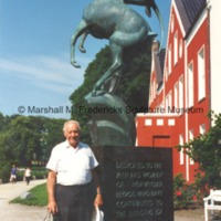 Ferd Prucke with Memorial to Norwegian Emigrants (Leaping Gazelle.tif