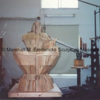 Front view of armature for Sun Worshipper covered in wooden lathe.tif