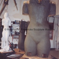 Front view of the plasteline model of the female figure for Star Dream Fountain with the plaster model in the background.tif