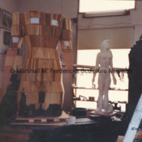 Front view of the torso armature for the female figure for Star Dream Fountain with plaster model in the background.tif