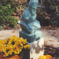 Frontside view of bronze Rabbit at a private residence surrounded by flowers and pumpkins.tif