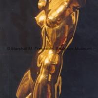 Frontside view of polished bronze Torso of Dancer against a black background.tif