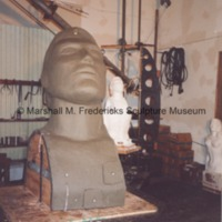 Frontside view of the plasteline model of the head for the male figure for Star Dream Fountain.tif