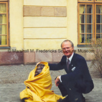 King Carl XVI Gustaf of Sweden with The Thinker wrapped in a yellow blanket.jpg