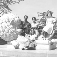 Marshall and Rosalind Fredericks and their daughters pose with The Lion and Mouse.jpg