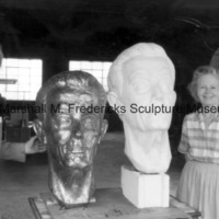 Marshall and Rosalind Fredericks pose with the plaster and bronze Floyd Starr.tif