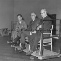 Marshall Fredericks, Ritchie and Burchfield judge a local art contest in Minneapolis-St. Paul from a rolling platform.jpg