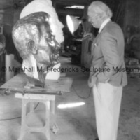 Marshall Fredericks admires the bronze and plaster Floyd Starr.tif