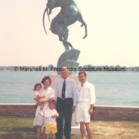 Marshall Fredericks and an unidentified family pose with Leaping Gazelle at their residence.jpg