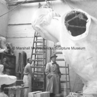 Marshall Fredericks and an unidentified man admire the plaster model for The Spirit of Detroit.jpg