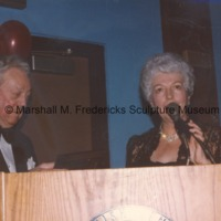 Marshall Fredericks and an unidentified woman speaking at the Finnish Club.tif