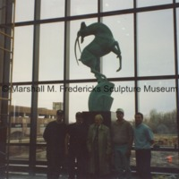 Marshall Fredericks and others pose with Leaping Gazelle at Chrysler Corporation.tif