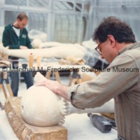 Marshall Fredericks' assistants work on preparing plaster figures for Saints and Sinners for the Marshall M. Fredericks Sculpture Museum in the greenhous studio.tif