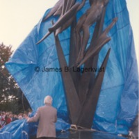 Marshall Fredericks begins to remove the tarp covering Freedom of the Human Spirit.tif