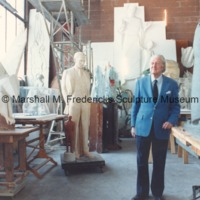 Marshall Fredericks in his Royal Oak studio surrounded by plaster models of his work.tif