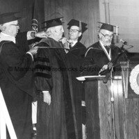 Marshall Fredericks is hooded as he receives his honorary degree from Dana College.jpg