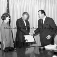 Marshall Fredericks is presented with The President's Committee on Employment of the Handicapped Award by Detroit Mayor Jerome Cavanagh.jpg