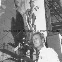 Marshall Fredericks poses in front of Youth in the Hands of God during its installation.jpg