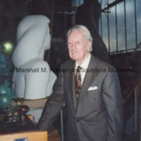 Marshall Fredericks poses with the plaster head and shoulders from the female figure for Star Dream Fountain.tif