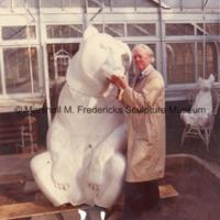 Marshall Fredericks poses with the plaster model for Two Bears.jpg