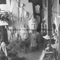 Marshall Fredericks poses with the plaster models for the Sir Winston Churchill Memorial and the John F. Kennedy Memorial in his Royal Oak studio.jpg