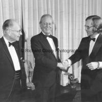 Marshall Fredericks shakes hands with William Henry Caswell III as Consul William Henry Caswell looks on.jpg