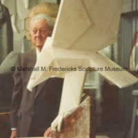 Marshall Fredericks standing behind the plaster model for Victory Eagle (American Eagle).tif