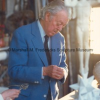 Marshall Fredericks working on a sculpture in the Royal studio with model for Star Dream Fountain in the foreground.tif