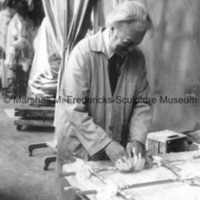 Marshall Fredericks working on an unidentified relief in his Royal Oak studio.tif