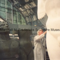 Marshall Fredericks working on the full-scale plaster model of the male figure for Star Dream Fountain.tif