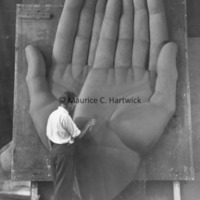 Marshall Fredericks working on the plasteline hands for Youth in the Hands of God.jpg