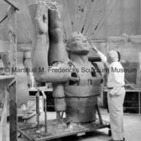 Marshall Fredericks working on the plasteline head of the full-scale male figure for Star Dream Fountain.jpg