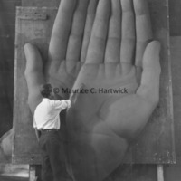 Marshall Fredericks working on the plasteline model of the hands for Youth in the God.jpg