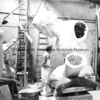 Marshall Fredericks working on the plaster model for The Spirit of Detroit.jpg